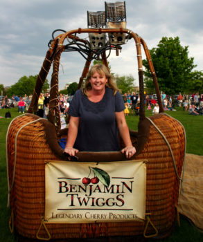 Owner Julie Millen in a Benjamin Twiggs hot air balloon basket